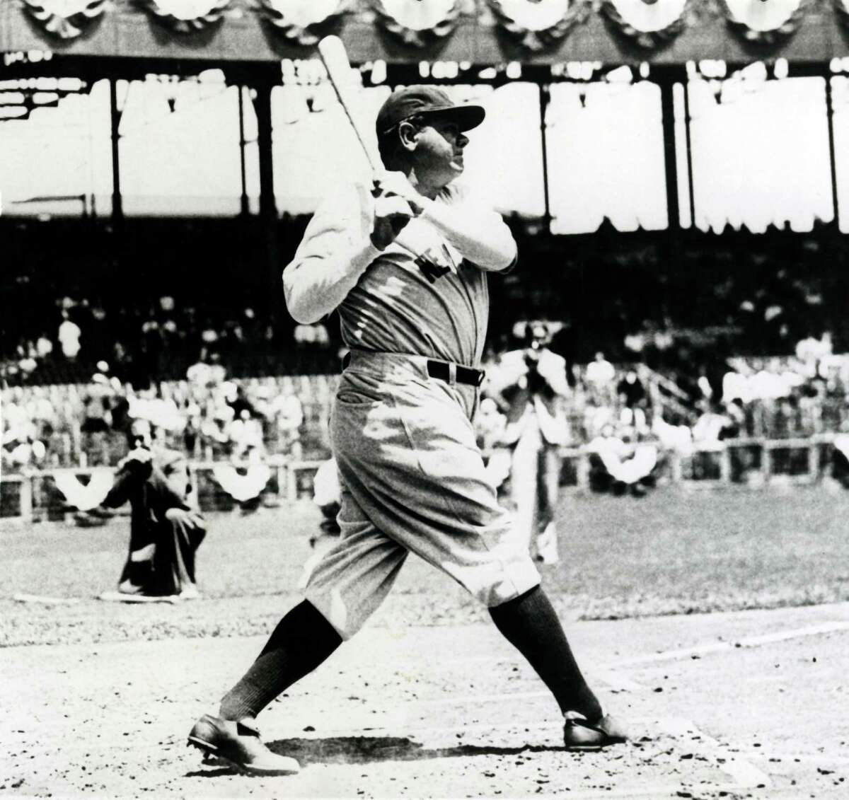 1920: Babe Ruth #3 of the New York Yankees swings at a pitch circa 1920.