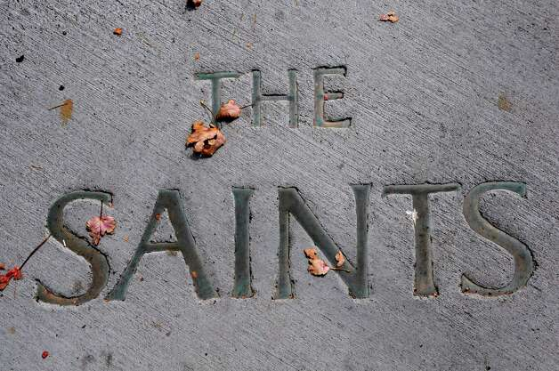"The words ""The Saints"" are seen embedded in cement outside the Athletic Recreation Center at Siena on Tuesday, Sept. 30, 2014 in Loudonville, N.Y. The college is talking about renovating the gym. (Lori Van Buren / Times Union) Photo: Lori Van Buren"