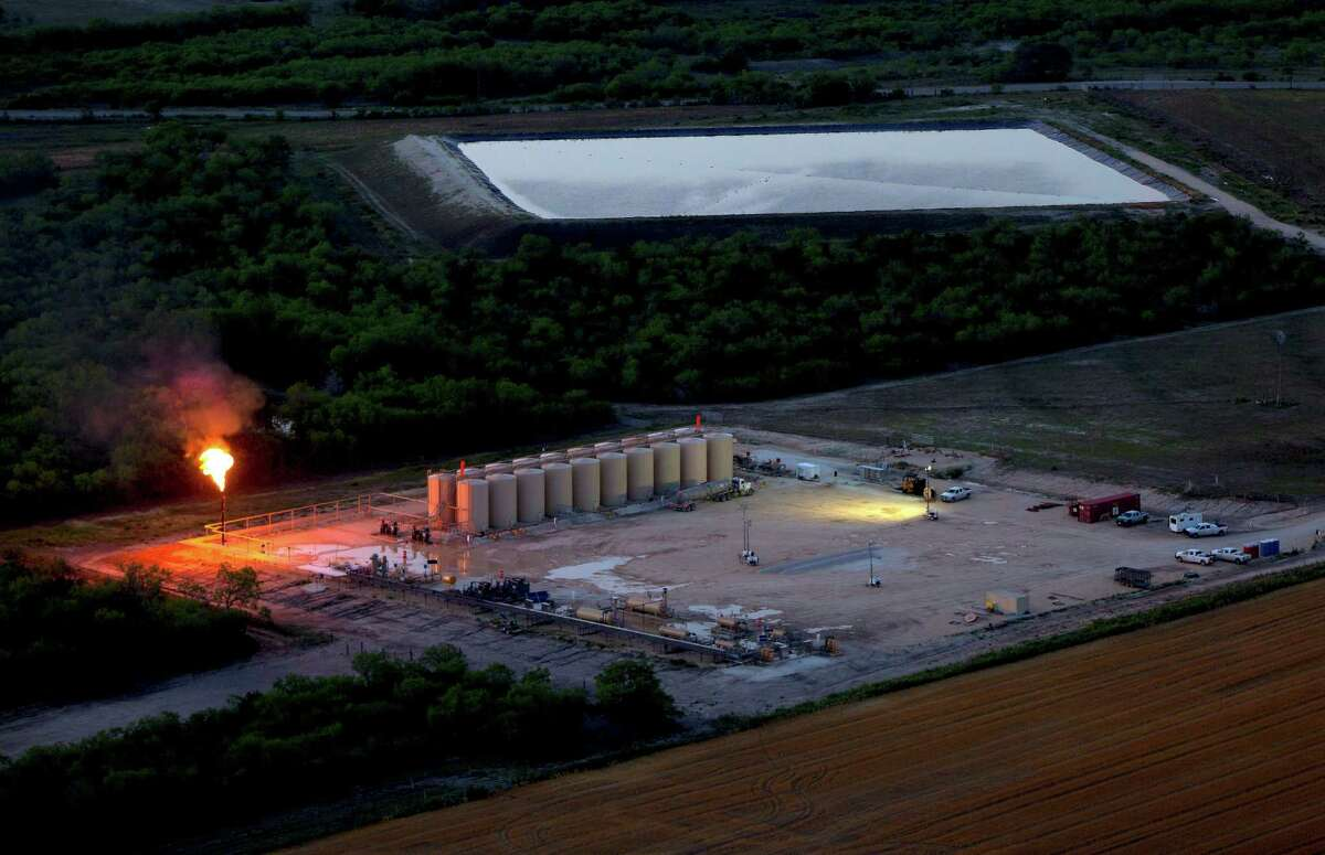 An oil production flare, also called a flare stack, is seen in a 2014 aerial image taken near Karnes City.
