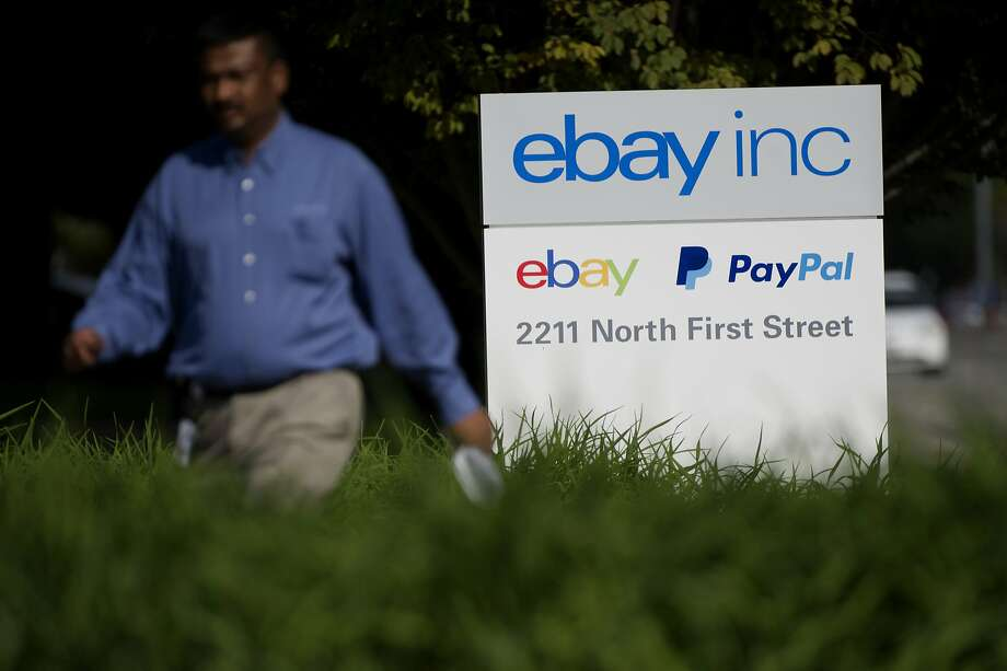 A pedestrian walks past eBay Inc. signage displayed at the company's headquarters in San Jose, California, U.S., on Tuesday, Sept. 30, 2014. EBay Inc. is spinning off its PayPal division, heeding demands by activist shareholder Carl Icahn and giving the business independence it can use to contend with rising competition from Apple Inc. and Google Inc. Photographer: David Paul Morris/Bloomberg Photo: David Paul Morris, Bloomberg