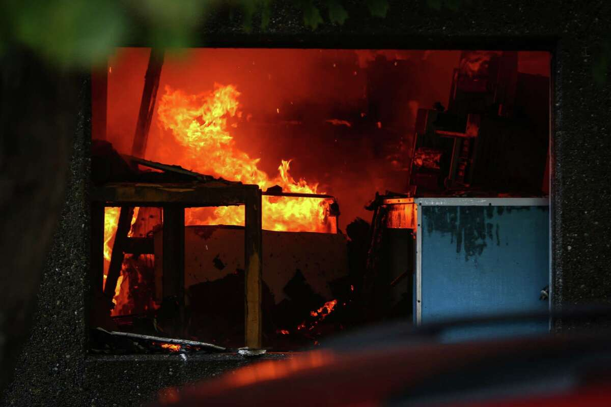 Flames are shown inside of ASKO Processing Inc., a metal-finishing company, in the heart of the Fremont neighborhood on Tuesday, September 30, 2014. The two-alarm fire completely destroyed the business and sent towering flames into the sky.
