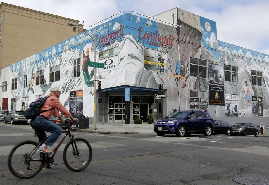 A bicyclist rides past Lombardi Sports at Polk and Jackson streets in San Francisco. Photo: Paul Chinn, The Chronicle