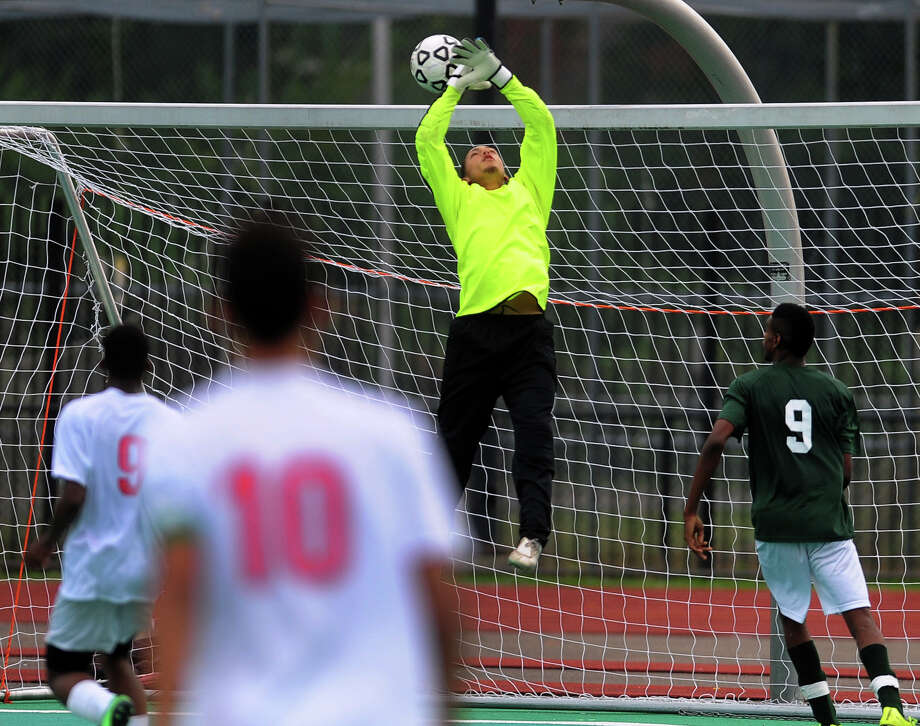 A corner kick by Central's John Fred Louis gets over Bassick goalie Jose Martinez-Valez, during boys soccer action against Bassick in Bridgeport, Conn., on Tuesday Sept. 30, 2014. Central's Diago Gardner headed the ball in to score. Central beat bassick 3-2. Photo: Christian Abraham / Connecticut Post