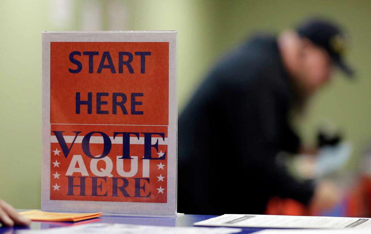 In this Wednesday, Feb. 26, 2014 photo, a voter prepares to cast his ballot at an early voting polling site, in Austin, Texas. (AP Photo/Eric Gay)