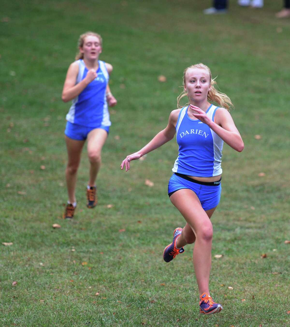 Darien High School's Amanda Percarpio, right, just before crossing the finish line with a time of 16:45 to win the girls high school cross country meet at Greenwich Point, Conn., Tuesday, Sept. 30, 2014. At left is Percarpio's Darien teammate Kate Halabi who finished second with a time of 16:47.