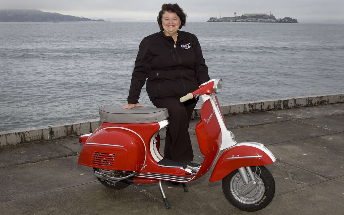 Photos of Jo Murray and her 1967 Vespa Super Sport. Photographed on August 29, 2014 at the San Francisco Marina near the St, Francis Yacht Club in San Francisco, CA.