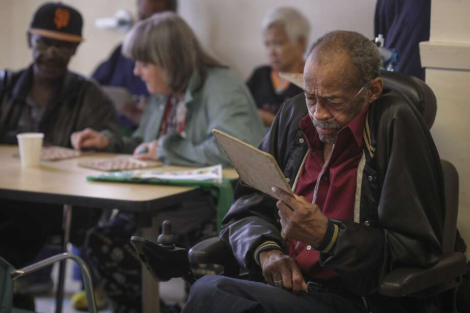 Norbert Charles partakes in a game of Bingo run by volunteers from the software startup Zendesk at the Curry Senior Center in the Tenderloin on September 24th 2014. A recent study by Stanford last week noted computer games for seniors might not work in sharpening the aging brain. Photo: Sam Wolson, Special To The Chronicle