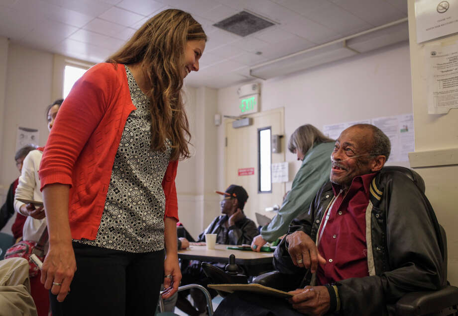 Megan Trotter, who works at Zendesk, talks with Norbert Charles at a game of Bingo at the Curry Senior Center in the Tenderloin. Photo: Sam Wolson / Special To The Chronicle / ONLINE_YES