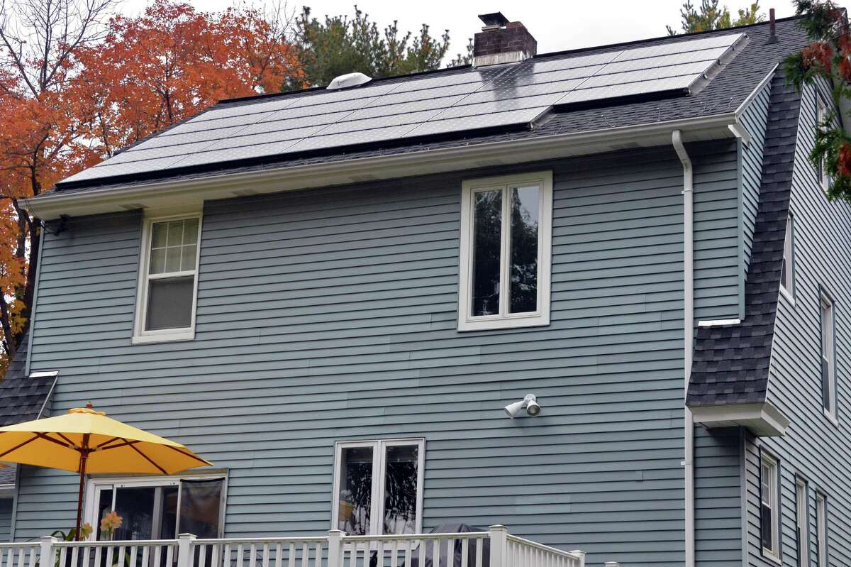 Solar panels atop the home of Richard Hartt and his wife Julie MacDonald Tuesday Sept. 30, 2014, in Troy, NY. (John Carl D'Annibale / Times Union)
