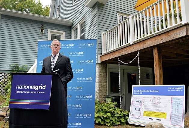Regional executive for National Grid, William Flaherty holds a home heating news conference at the home of Richard Hartt and his wife Julie MacDonald Tuesday Sept. 30, 2014, in Troy, NY.   (John Carl D'Annibale / Times Union) Photo: John Carl D'Annibale / 10028816A