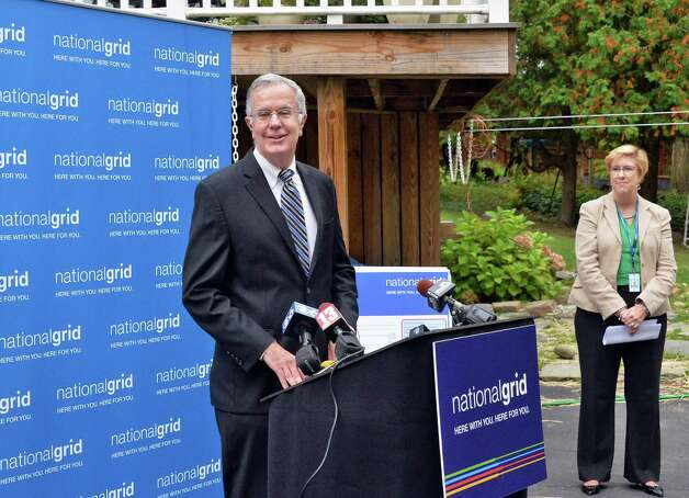 Regional executive for National Grid, William Flaherty, left, and National Grids commercial leader in upstate NY Renee Devine hold a home heating news conference at the home of Richard Hartt and his wife Julie MacDonald Tuesday Sept. 30, 2014, in Troy, NY.   (John Carl D'Annibale / Times Union) Photo: John Carl D'Annibale / 10028816A