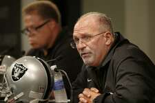 New head coach Tony Sparano (right) sat with general manager Reggie McKenzie at the podium. The Oakland Raiders named Tony Sparano as the team's interim head coach after the firing of Dennis Allen Tuesday September 30, 2014.