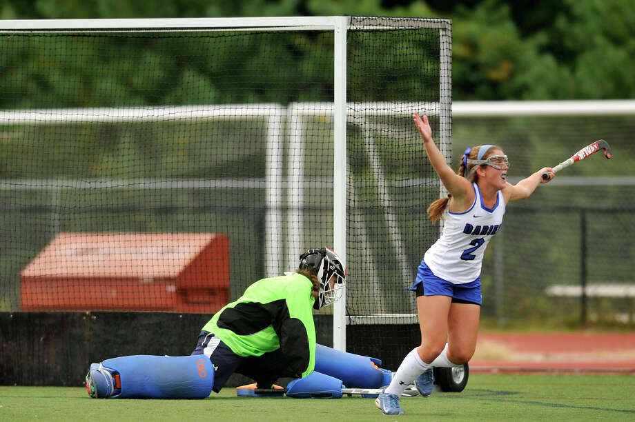 Darien's Georgia Cassidy celebrates after scoring on Greenwich goalie Leah Hotaling during their field hockey game at Darien High School in Darien, Conn., on Tuesday, Sept. 30, 2014. Darien won, 7-1. Photo: Jason Rearick / Stamford Advocate