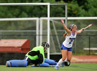 Darien's Georgia Cassidy celebrates after scoring on Greenwich goalie Leah Hotaling during their field hockey game at Darien High School in Darien, Conn., on Tuesday, Sept. 30, 2014. Darien won, 7-1.