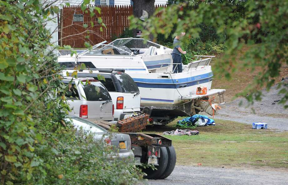 Vehicles and a boat are seen on the property of Gregory Massengale on Monday Sept. 29, 2014 in Clifton Park, N.Y. Massengale owes $9,400 in the city of Troy for unpaid water bills and fees on four of the five apartments he owns.  (Lori Van Buren / Times Union) Photo: Lori Van Buren / 10028805A
