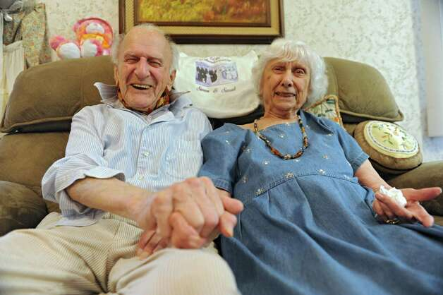 98-year-old Joseph Hrachian and his wife, Sarah, 94, who recently celebrated their 75th wedding anniversary, sit on their couch in their home on Thursday, Sept. 25, 2014 in Guilderland, N.Y. (Lori Van Buren / Times Union) Photo: Lori Van Buren / 00028763A