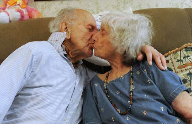 98-year-old Joseph Hrachian and his wife, Sarah, 94, who recently celebrated their 75th wedding anniversary, kiss as  they sit on their couch in their home on Thursday, Sept. 25, 2014 in Guilderland, N.Y. (Lori Van Buren / Times Union) Photo: Lori Van Buren / 00028763A