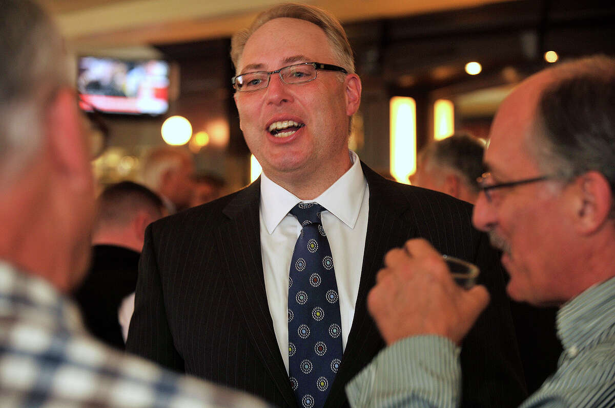James Gueltzow, executive vice president for Washington Trust Mortgage Company, chats with others during an announcement party for the opening of Washington Trust Mortgage Company at Ten Twenty Post Oyster Bar in Darien, Conn., on Tuesday, Sept. 30, 2014.