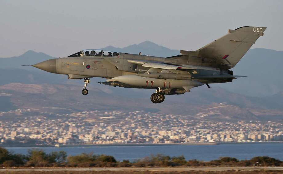 In this image released by Britain's Royal Air Force on Tuesday, an RAF Tornado lands at RAF Akrotiri Cyprus airbase upon returning from a mission against Islamic State miltants who were fighting Kurdish forces in northwest Iraq. Photo: Cpl Neil Bryden, HOPD / RAF