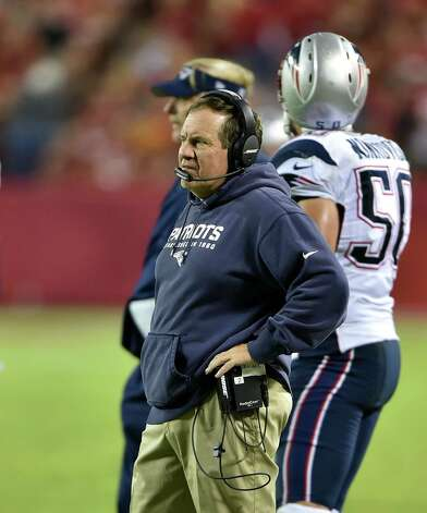 KANSAS CITY, MO - SEPTEMBER 29: Head coach Bill Belichick of the New England Patriots looks on from the sidelines during the game against the Kansas City Chiefs at Arrowhead Stadium on September 29, 2014 in Kansas City, Missouri.  (Photo by Peter Aiken/Getty Images) ORG XMIT: 504234441 Photo: Peter Aiken / 2014 Getty Images