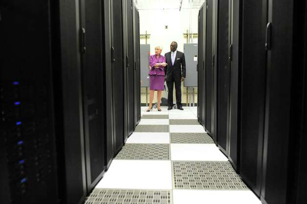 SUNY Chancellor Nancy L. Zimpher, left, and President Robert J. Jones tour the new $26M data center in the Information Technology building on Tuesday, Sept. 30, 2014, at University at Albany in Albany, N.Y. (Cindy Schultz / Times Union) Photo: Cindy Schultz / 10028813A