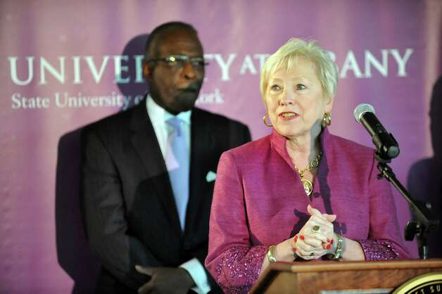 SUNY Chancellor Nancy L. Zimpher, right, joins President Robert J. Jones during a ceremony at the new Information Technology building on Tuesday, Sept. 30, 2014, at University at Albany in Albany, N.Y. (Cindy Schultz / Times Union) Photo: Cindy Schultz / 10028813A