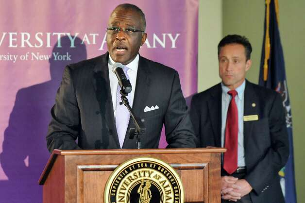 President Robert J. Jones, left, joins Assemblyman Peter Lopez during a ceremony at the new Information Technology building on Tuesday, Sept. 30, 2014, at University at Albany in Albany, N.Y. (Cindy Schultz / Times Union) Photo: Cindy Schultz / 10028813A