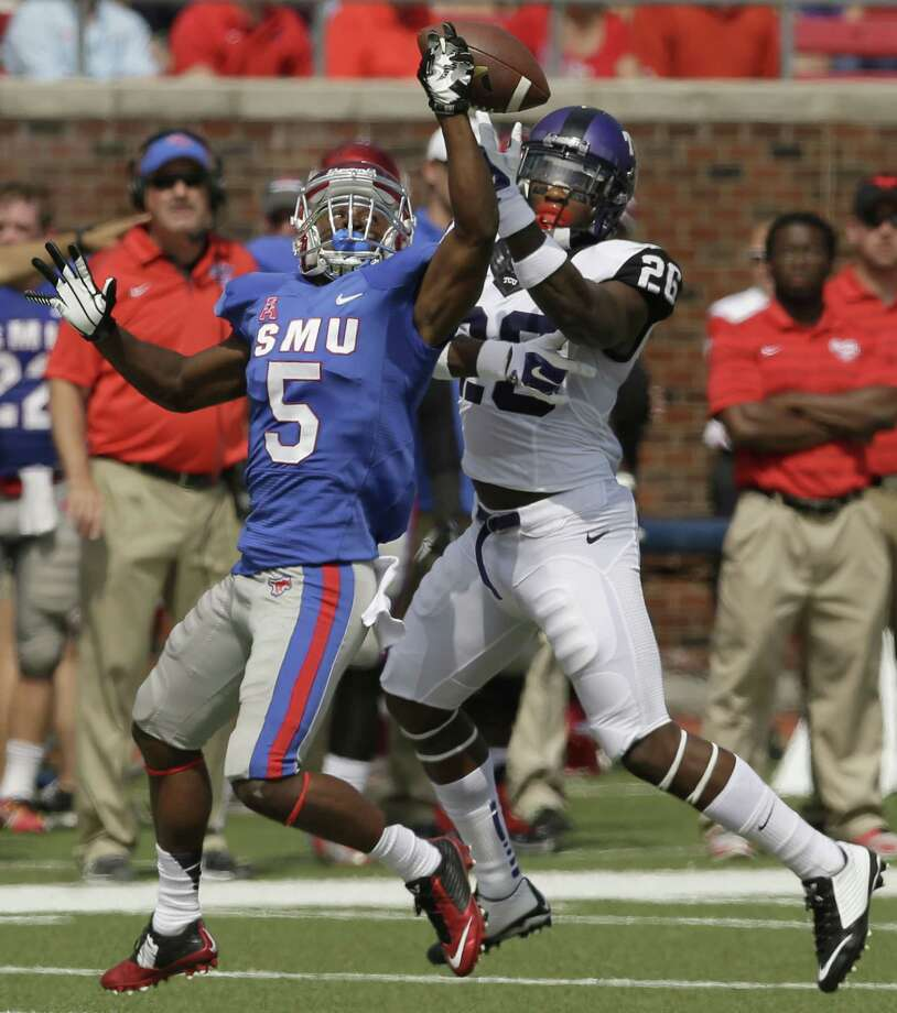 TCU safety Derrick Kindred (26) breaks up a pass against SMU wide receiver Cedric Lancaster (5) during the first half of an NCAA college football game Saturday, Sept. 27, 2014, in Dallas. (AP Photo/LM Otero)   ORG XMIT: TXMO102 Photo: LM Otero / AP