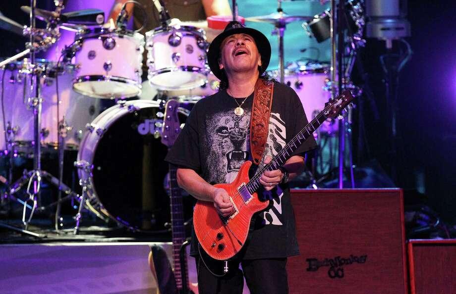 Legendary performer and guitarist Carlos Santana performs at the Tobin Center on Tuesday, Sept. 30, 2014. Photo: Kin Man Hui, San Antonio Express-News / ©2014 San Antonio Express-News