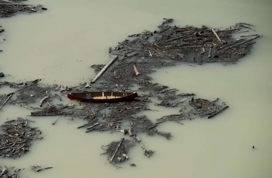 This Tuesday, Aug. 5, 2014 aerial photo shows the damage caused by a tailings pond breach at the Mount Polley Mine in British Columbia. (AP Photo/The Canadian Press, Jonathan Hayward)