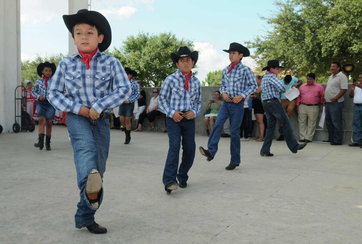 Eduardo Ortiz, 9, left, and Grupo Ollin Quetzali in Conroe perform over the weekend during the Pachanga at the Park voting drive in Conroe.