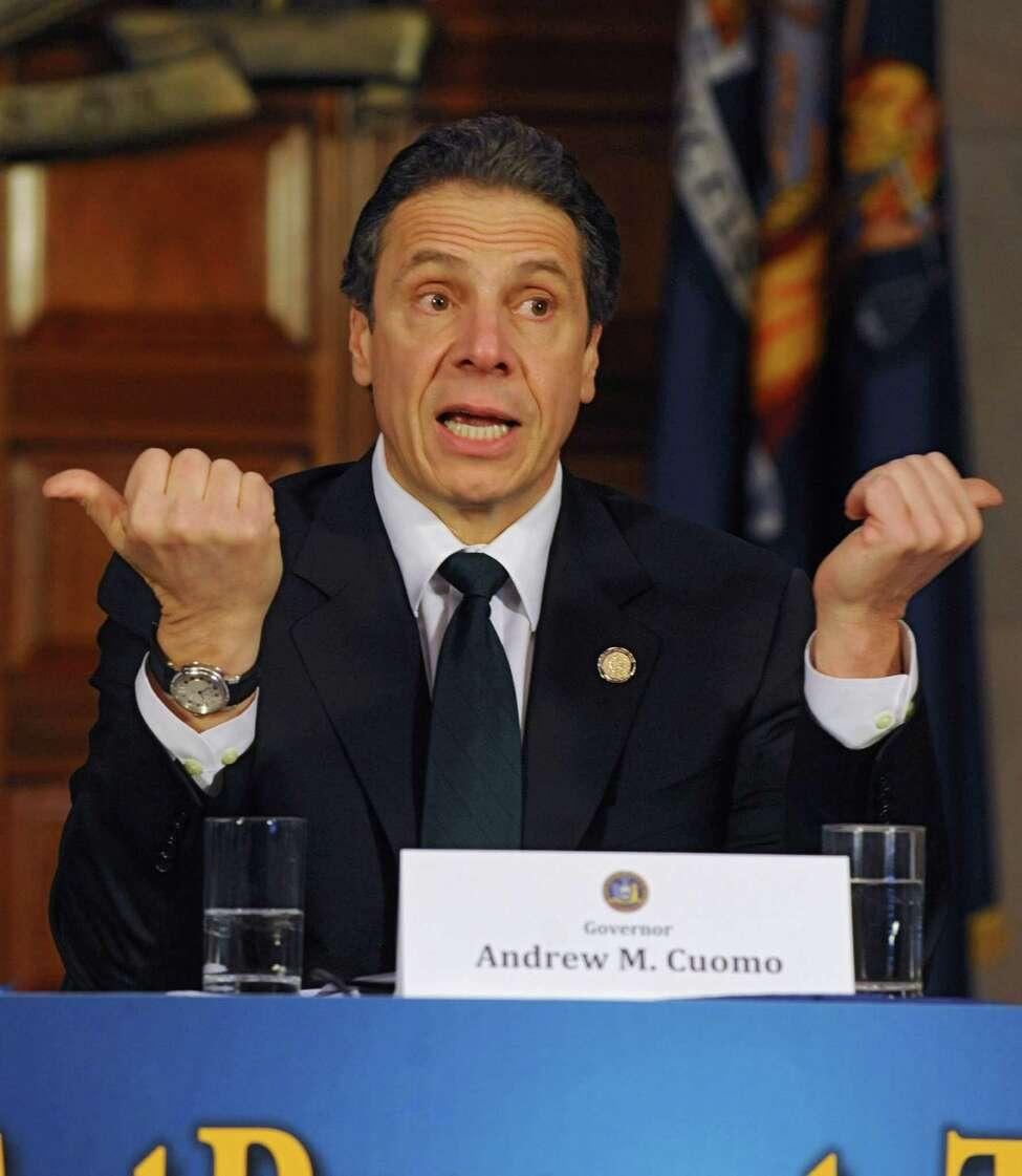 Gov. Andrew Cuomo is joined by local officials to talk about a property tax freeze at the Capitol on Monday, March 17, 2014 in Albany, N.Y. (Lori Van Buren / Times Union)