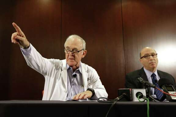 Dr. Edward Goodman, left, epidemiologist at Texas Health Presbyterian Hospital Dallas, points to a reporter for a question as Dr. Mark Lester looks on during a news conference about an Ebola infected patient they are caring for in Dallas, Tuesday, Sept. 30, 2014. Federal health officials confirmed the first Ebola case diagnosed in the United States. (AP Photo/LM Otero)