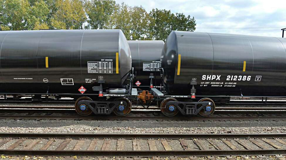 Railway oil cars parked behind housing projects on South Pearl St. Tuesday Sept. 30, 2014, in Albany, NY. (John Carl D'Annibale / Times Union)