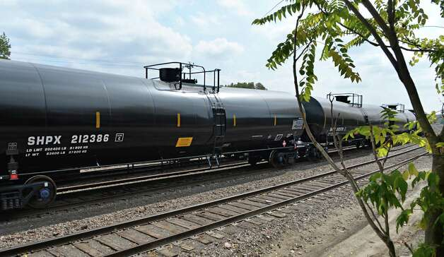 Railway oil cars behind housing projects on South Pearl St. Tuesday Sept. 30, 2014, in Albany, NY.  (John Carl D'Annibale / Times Union) Photo: John Carl D'Annibale / 00028833A