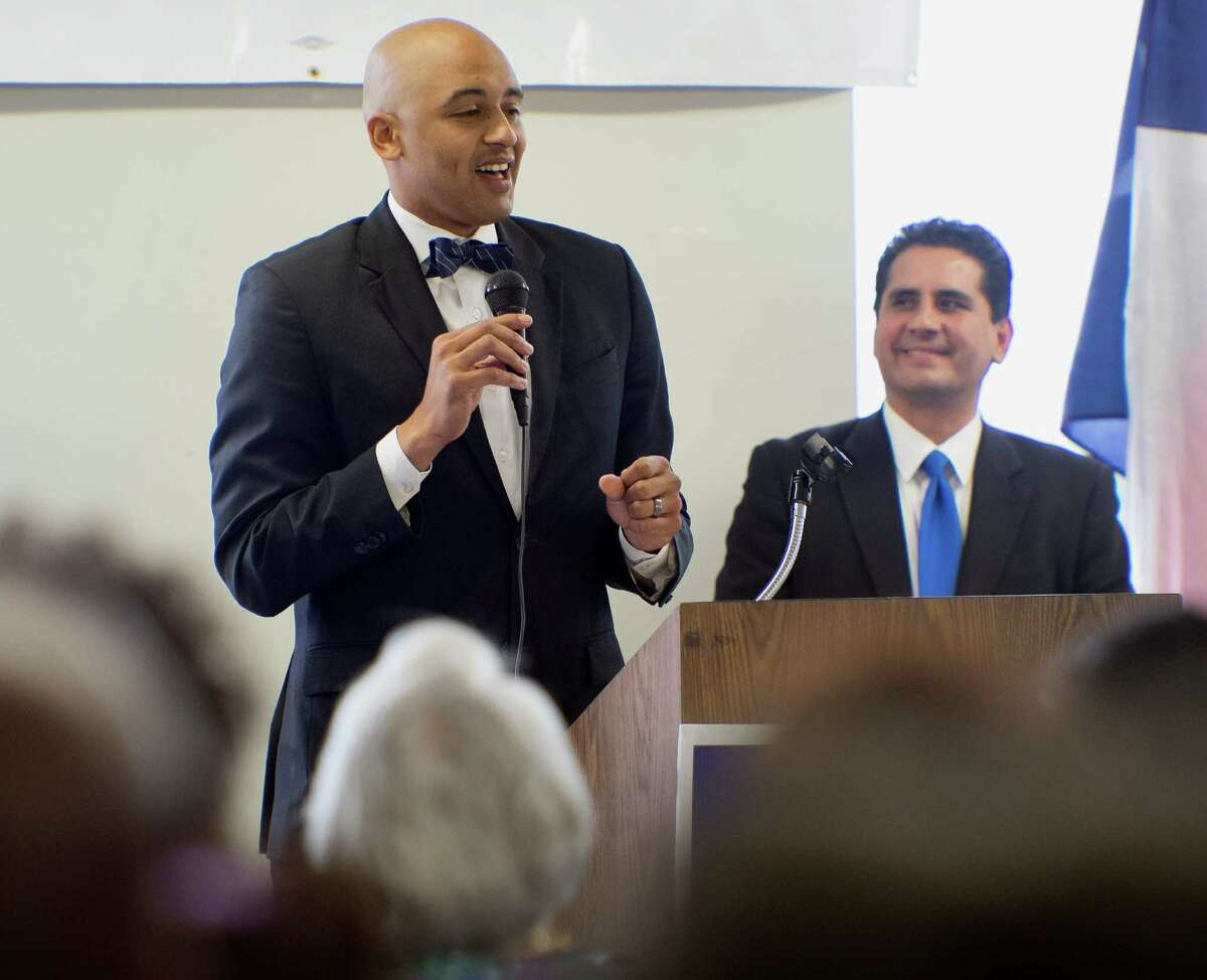 City Council District 2 candidate Alan Warrick II, left, speaks as Bexar County Democratic Party chairman Manuel Medina looks on, during a candidate forum, Saturday, Sept. 27, 2014, at Second Baptist Church in San Antonio. (Darren Abate/For the Express-News)
