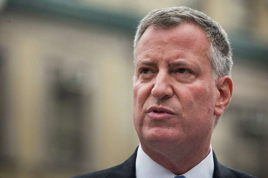NEW YORK, NY - SEPTEMBER 30:  New York City Mayor Bill de Blasio speaks at a press conference before signing an executive order raising the living wage law on September 30, 2014 in New York City. Under the new living wage law, which takes effect today, employees of companies that receive more than $1 million in subsidies from the city government will need to pay their employees between $11.50 - $13.13 an hour, depending on whether or not the employee receives benefits. The law is expected to effect thousands of people working in industries from retail to fast food.  (Photo by Andrew Burton/Getty Images) Photo: Andrew Burton, Staff / 2014 Getty Images