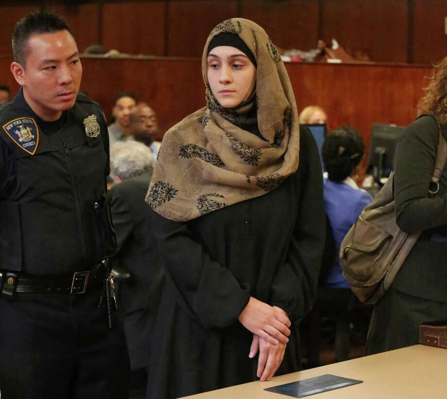 "Ailina Tsarnaeva, sister of Boston Marathon bombing suspect Dzhokhar Tsarnaev, is escorted by a court officer during her appearance in Manhattan Criminal Court, Tuesday, Sept. 30, 2014, in New York. Authorities allege Tsarnaeva, of North Bergen, N.J., claimed people she knew could bomb the home of a woman who was previously involved with her husband. Her lawyer Susan Marcus said Tuesday that the claim is ""uncorroborated."" Bail was set at $5,000. (AP Photo/The Daily News, Jefferson Siegel, Pool) Photo: Jefferson Sigel, POOL / Pool New York Daily News"