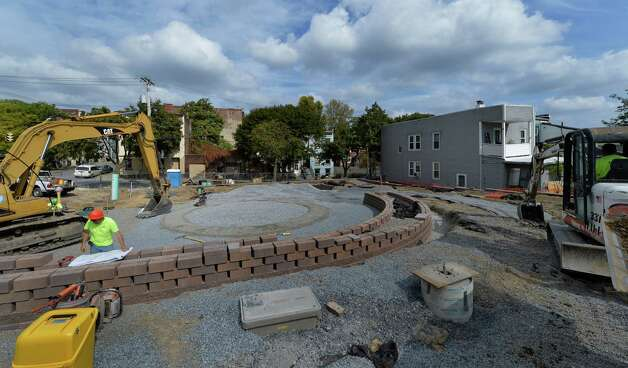 Work continues on an Arbor Hill park at the corner of 2nd Street and N. Swan Tuesday afternoon, Sept. 30, 2014, in Albany, N.Y. The American Planning Association announced that the neighborhood was chosen as one of the 10 great neighborhoods in America for 2014. (Skip Dickstein/Times Union) Photo: SKIP DICKSTEIN / 00028835A