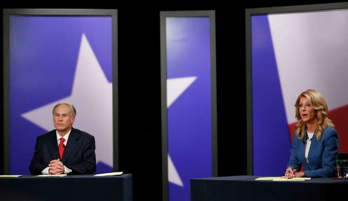 Texas State Senator Wendy Davis (right), Democratic candidate, and Texas Attorney General Greg Abbott (left), Republican candidate, during the final gubernatorial debate in a KERA-TV studio in Dallas Tuesday September 30, 2014. (Andy Jacobsohn/The Dallas Morning News)