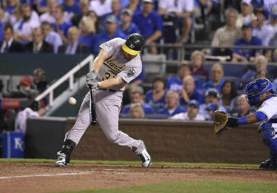 The Oakland Athletics' Brandon Moss hits a three-run home run in the sixth inning against the Kansas City Royals in the American League Wild Card at Kauffman Stadium in Kansas City, Mo., on Tuesday, Sept. 30, 2014. (David Eulitt/Kansas City Star/MCT) Photo: DAVID EULITT, MBR / Kansas City Star