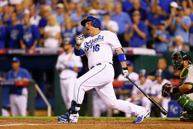 KANSAS CITY, MO - SEPTEMBER 30:  Billy Butler #16 of the Kansas City Royals hits an RBI single in the first inning against the Oakland Athletics during the American League Wild Card game at Kauffman Stadium on September 30, 2014 in Kansas City, Missouri.  (Photo by Dilip Vishwanat/Getty Images) ORG XMIT: 516005617 Photo: Dilip Vishwanat / 2014 Getty Images