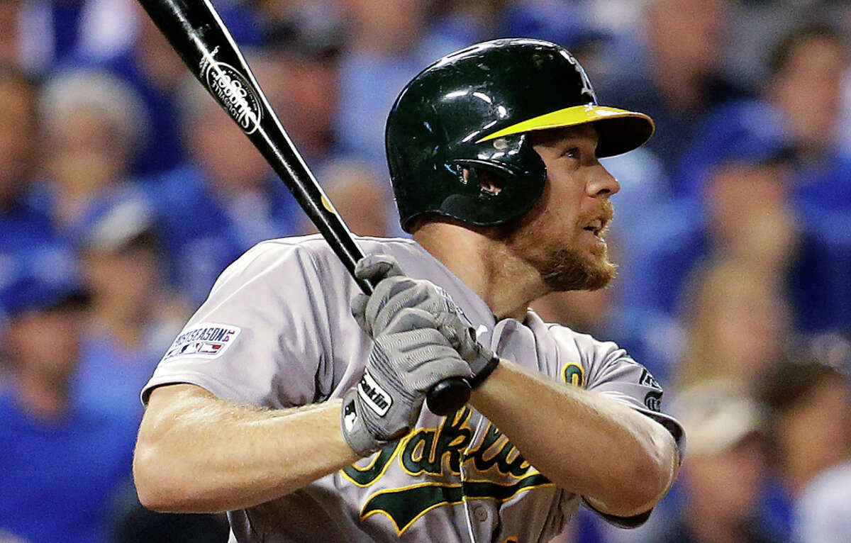 Brandon Moss watches the trajectory of his second home run of the wild-card game, a three-run shot in the sixth inning.