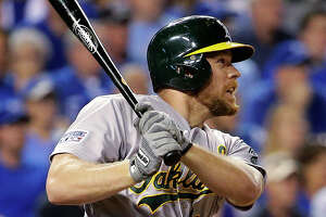 While healing from hip surgery, A's Moss notices personnel influx - Photo
