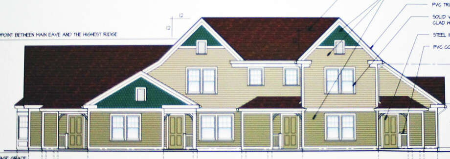 An architect's drawing of the proposed new units for the Pine Tree Lane housing complex run by the Fairfield Housing Authority. The Town Plan and Zoning Commission held a public hearing on the application Tuesday. Photo: Genevieve Reilly / Fairfield Citizen