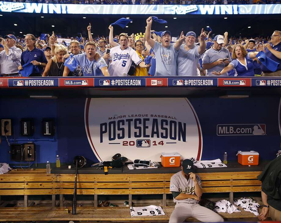 Oakland Athletics relief pitcher Luke Gregerson sits in the dugout after Oakland lost 9-8 in 12 innings to the Kansas City Royals in the AL wild-card playoff baseball game Tuesday, Sept. 30, 2014, in Kansas City, Mo. (AP Photo/Jeff Roberson) Photo: Jeff Roberson, Associated Press
