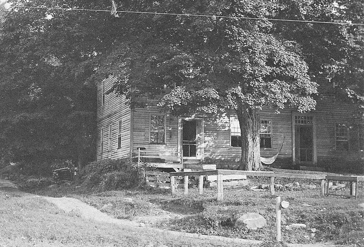This undated view of Seven Hearths in Kent shows a dirt path to the left of the building that would become Studio Hill Road. October 2014 Courtesy of the Kent Historical Society