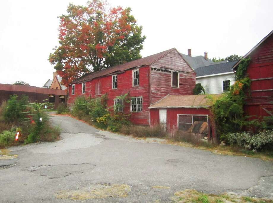 Town-owned property in the New Milford village center, including two old barns off Church Street,  is now targeted for outdoor art use. The property, located between Main Street and East Street, adjoins the east side of the New Milford Public Library property, left. October 2014. Photo: Norm Cummings / The News-Times