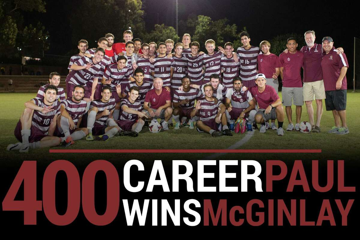 Coach Paul McGinlay (center) celebrates his 400th career victory with his Trinity men's soccer team on Monday, Sept. 29, 2014. The Tigers defeated Texas Lutheran 1-0.