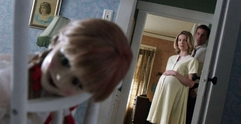 """""""Annabelle""""IMDb: 6.6/10Review by Peter Hartlaub: Demonic doll delivers satisfying chills3 starsIt's 1969, and Mia Gordon seems to have it all.  A doctor husband and a baby on the way. Perfect """"Mad Men""""/Betty Draper hair. A kind priest who looks just like F. Murray Abraham. This would be early-Nixon-era conservative domestic bliss, if it wasn't for that demonically possessed doll collection …  """"Annabelle,"""" a prequel/spinoff to the superb 2013 throwback horror film """"The Conjuring,"""" is filled with good and bad. The production schedule was rushed, and it shows. The script highlights an annoying lack of self-preservation on behalf of the protagonists. But the movie tries to be more than just a creepy doll freakout, and delivers the requisite scares. Photo: New Line / ONLINE_YES"""